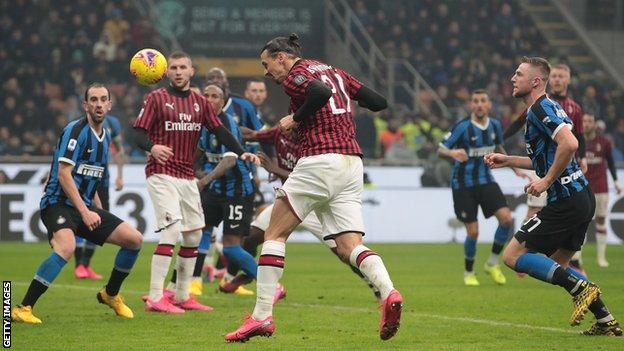 Inter stun Milan to go top of Serie A